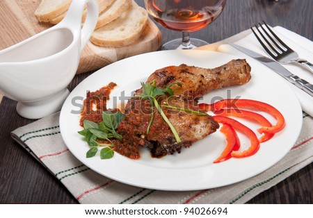Tasty grilled chicken with pepper sauce