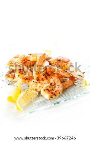 tasty grilled prawn salad with lemon and parsley - stock photo