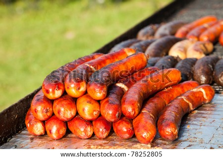 Tasty grilled sausages on barbecue - stock photo