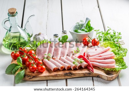 Tasty ham with herbs and pepper - stock photo