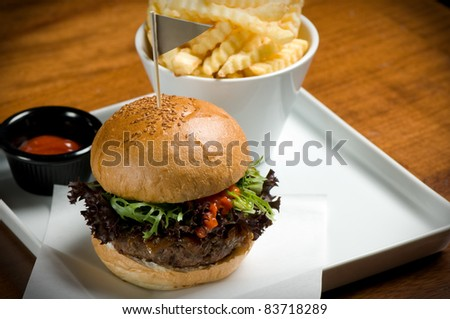 Tasty hamburger with fries.