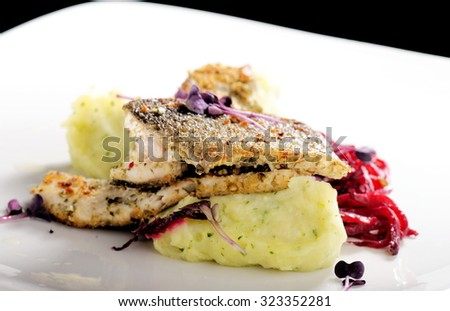 Tasty healthy fish fillet with potato puree with spices and garlic sauce - stock photo