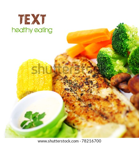 Tasty healthy fish fillet with steamed vegetables, isolated on white background, border with text space - stock photo