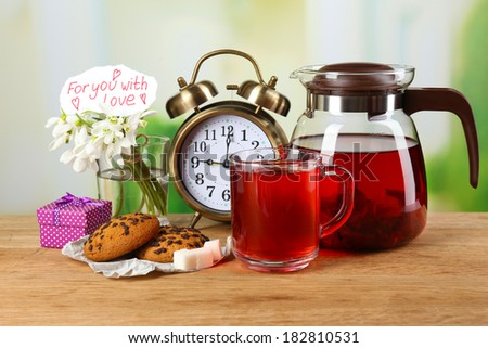 Tasty herbal tea and cookies on wooden table