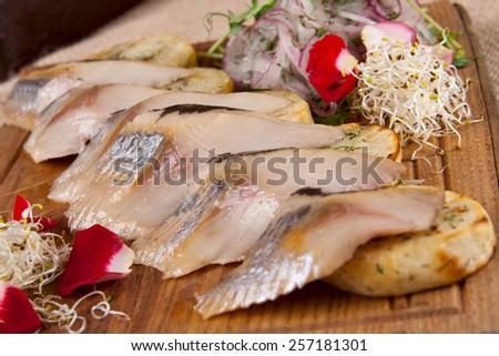 Tasty herring with potato - stock photo