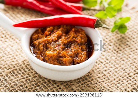 tasty homemade chili pesto in a small bowl - stock photo