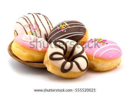 Tasty homemade doughnuts in a wooden plate on white background