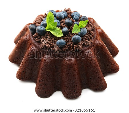 Tasty homemade muffin with chocolate chip and blueberries isolated on white - stock photo