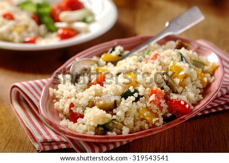 Tasty Horizontal quinoa menu with red and white napkin in a beautiful dish. Veggie Concept.