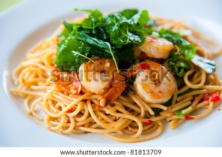 tasty hot and spicy spaghetti with cream, cheese and parsley close up - stock photo