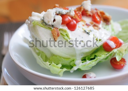 Tasty Iceberg Lettuce Wedge, Topped with Tomatoes, Blue Cheese and Bacon - stock photo