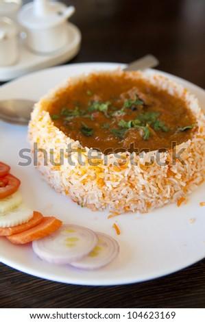Tasty Indian Cuisine Biryani chicken rice - stock photo