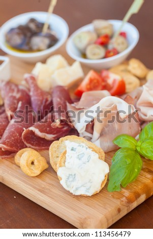 Tasty italian aperitif on chopping board