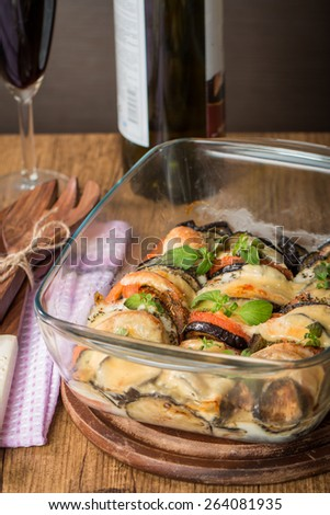 Tasty Italian dish, appetizer with eggplant, cheese mozzarella  and tomato sauce in glass cup - stock photo