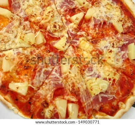 Tasty Italian pizza with ham and pineapple