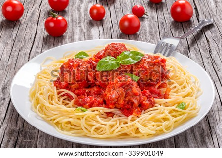 tasty italian spahgetti with meatballs and tomato sauce, close-up