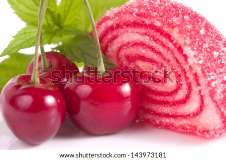 Tasty jelly candy with cherry on the white - stock photo