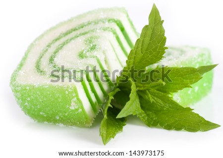 Tasty jelly candy with mint on the white