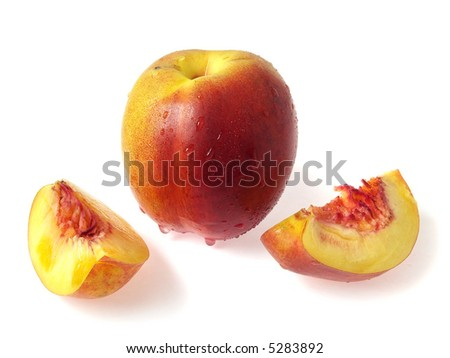 Tasty juicy pieces of nectarine on a white background with water droplets - stock photo