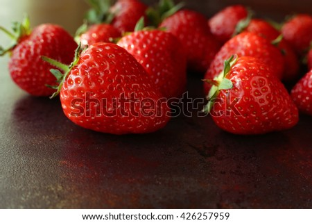 Tasty juicy strawberries macro photo. Red fresh strawberries background. Rich summer strawberry crops, organic farming - stock photo