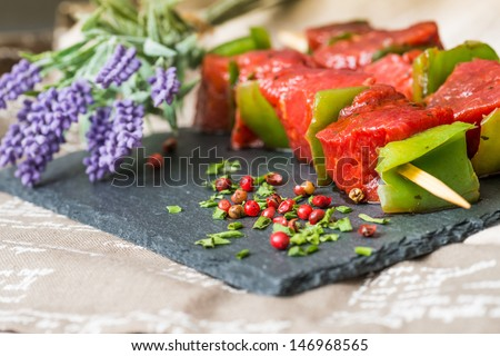 tasty kabobs with vegetables on a slate plate  - stock photo