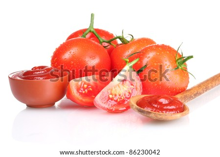 Tasty ketchup in wooden spoon and tomato isolated on white - stock photo