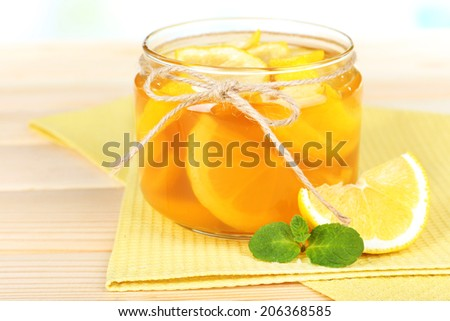 Tasty lemon jam on table close-up - stock photo