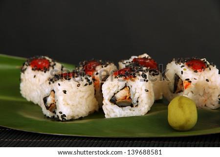 Tasty Maki sushi - Roll on green leaf close-up - stock photo