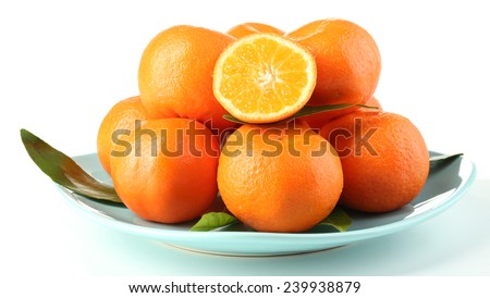 Tasty mandarins on plate isolated on white