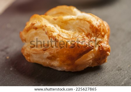 Tasty melted cheese baked pastry  - stock photo