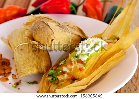 Tasty mexican tamale with guacamole and cheese stock photo