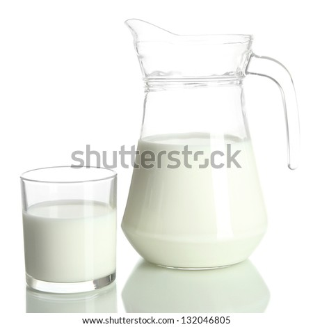 Tasty milk in jug and glass of milk isolated on white - stock photo