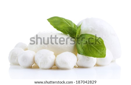Tasty mozzarella with basil isolated on white - stock photo