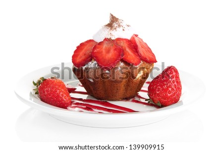 Tasty muffin cake with strawberries and chocolate on plate, isolated on white