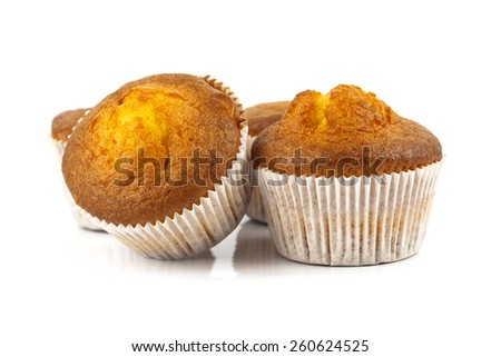 Tasty muffins on white background - stock photo