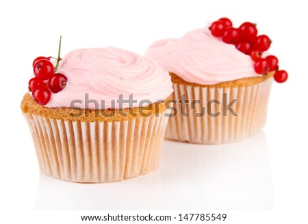 Tasty muffins with berries isolated on white