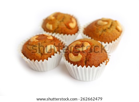 Tasty muffins with cashew nut isolated on white background - stock photo