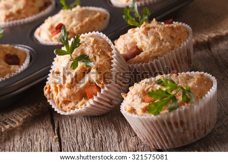 Tasty muffins with ham and cheese close-up on the table. Horizontal - stock photo