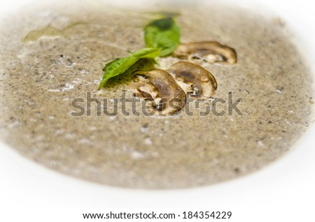 tasty mushroom soup with champignons in white plate - stock photo