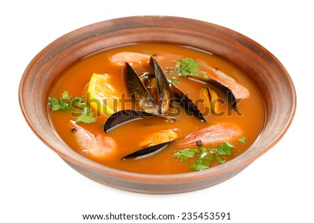 Tasty mussel soup with shrimps in bowl isolated on white - stock photo