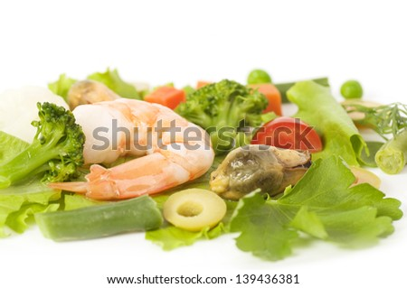 Tasty mussels and prawn food with salad and olives