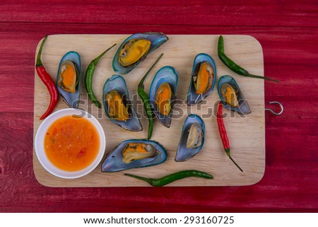Tasty Mussels steam on wood background - stock photo