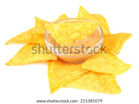 Tasty nachos and bowl with sauce isolated on white - stock photo