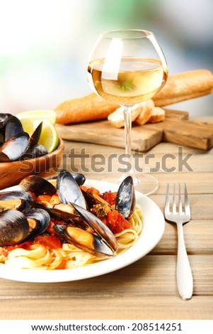 Tasty noodles with mussels on table, close up - stock photo