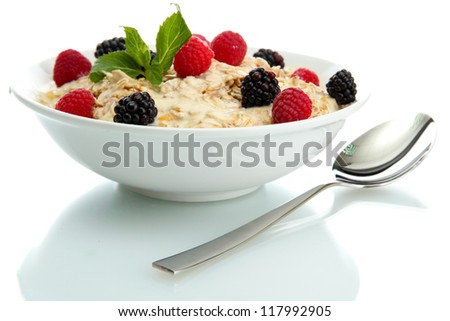 tasty oatmeal with berries, isolated on white - stock photo