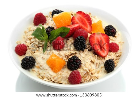 tasty oatmeal with berries, isolated on white