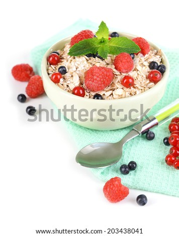 Tasty oatmeal with berries isolated on white - stock photo