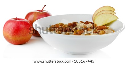 Tasty oatmeal with raisins and apples isolated on white - stock photo