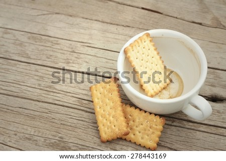 Tasty of crackers on a wood table - stock photo