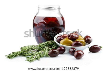 Tasty olives in glass jar, isolated on white - stock photo